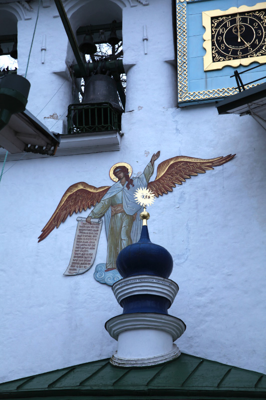 angel bearing text and bells and clock from Pskov Monastery of the Caves