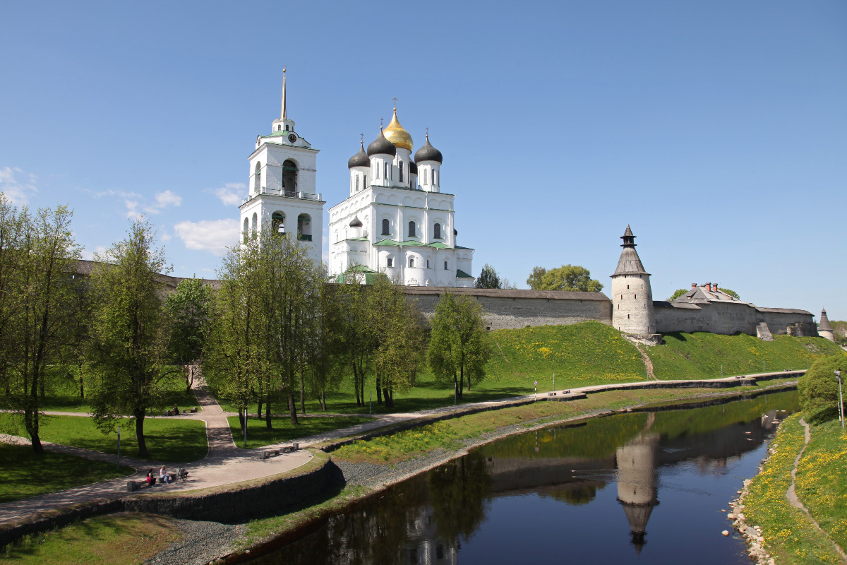 Trinity Cathedral and Belltower within the walls of the Pskov Krom (or Kremlin) along the banks of the Pskova River