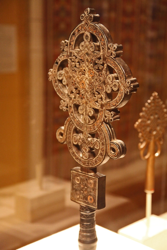 Processional Cross c. 1500 of wood with metal inlay attributed to Ezra c 1460 - 1522 of the Stephanite monastic order of Tigray region of Ethiopia in MMA in NYC